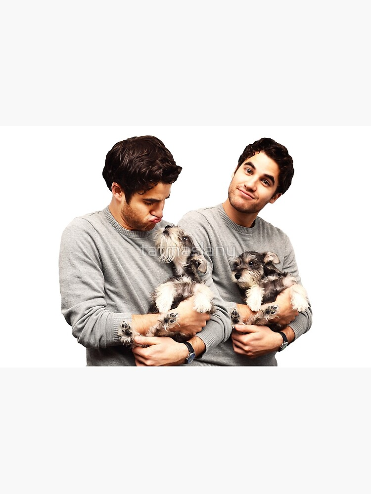 Darren Criss holding a puppy by tatmaslany