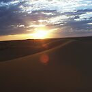The Sun sinks in the Dahna Dunes by Peter Doré