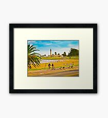 Two men riding bicycles Framed Print