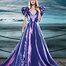 Woman wearing beautiful long blue dress at waterfront art photo print by ArtNudePhotos
