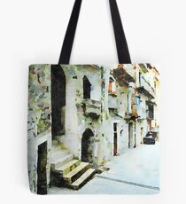 Car parked in an alley of the historic center Tote Bag