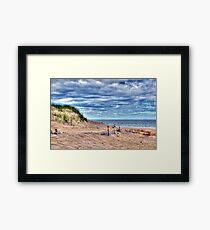 Beach Under Cloudy Skies Framed Print