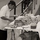 Making sandwiches by Francisco Larrea