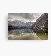 Reflections of an Alpine lake Canvas Print