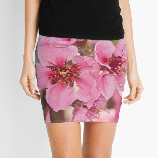peach flowers close-up Mini Skirt