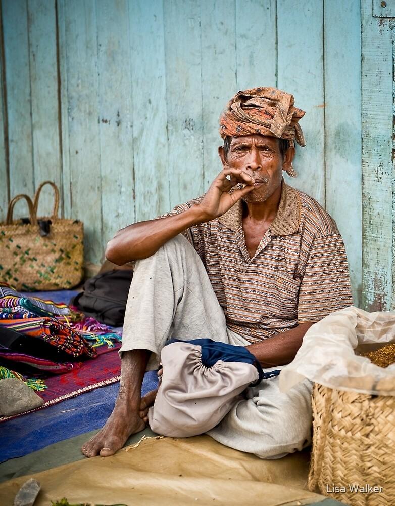 Resting at the market - Timor-Leste  by Lisa Walker