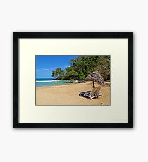 Lounge chairs with parasol on tropical beach Framed Print