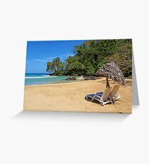 Lounge chairs with parasol on tropical beach Greeting Card