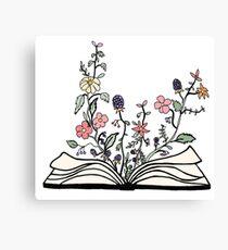 Blumen wachsen aus Buch Leinwanddruck