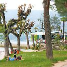 couple sunbathing next to lake garda by xxnatbxx