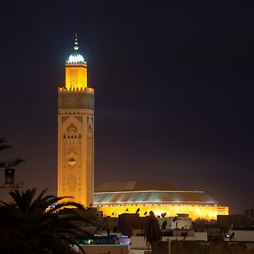 Casablanca Morocco. The enormous Hassan II Mosque at dusk towering over the buildings of the Old Medina by stuwdamdorp