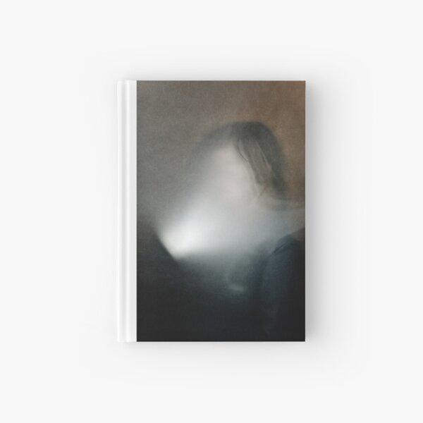 light in face Hardcover Journal