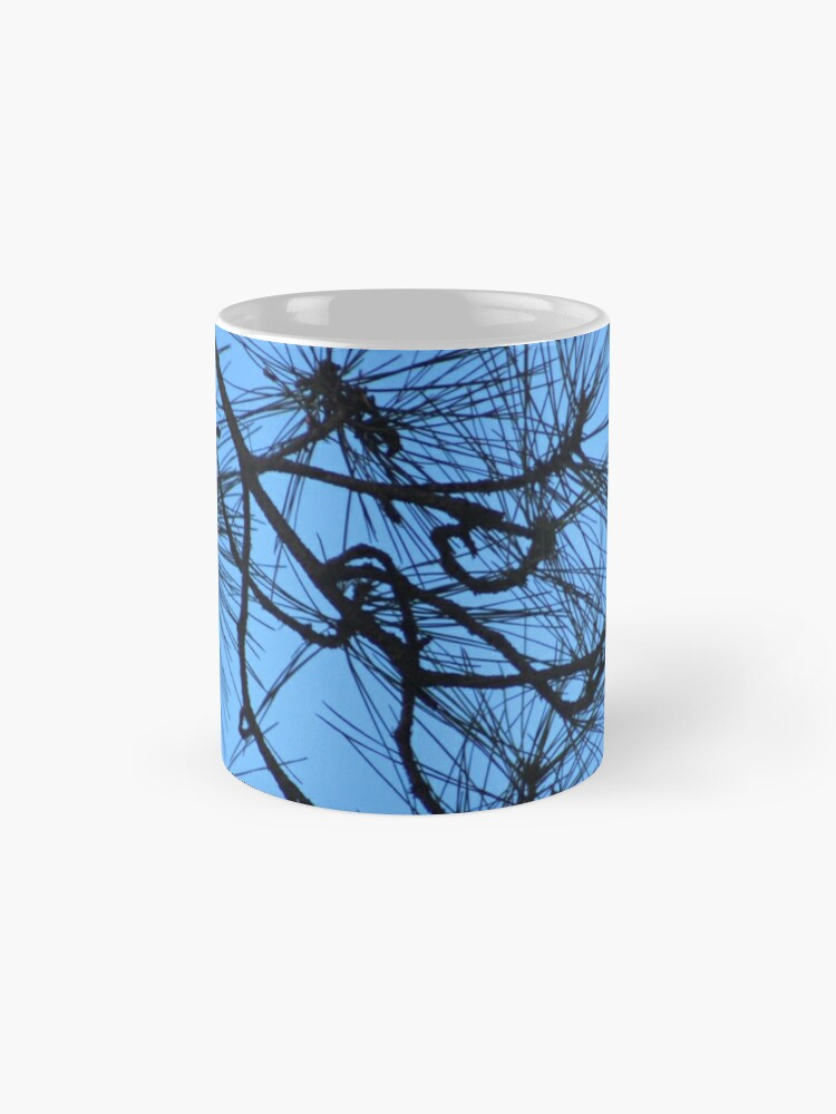 Alternate view of Twisty bare trees in blue skies Standard Mug