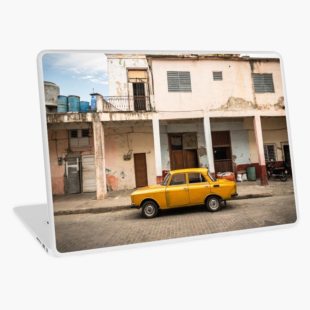 Bright yellow vintage car in La Havana, Cuba. Laptop Skin