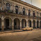 Old, damaged, vintage car in La Havana, Cuba. by jonathankemp
