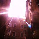 shot of light flare through buildings on a gondola in venise by xxnatbxx