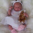 What a little doll by Cheryl J Newman