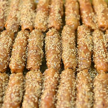 Marrakech Morocco Food Traditional sweet pastries coated with sesame seeds and honey. by stuwdamdorp