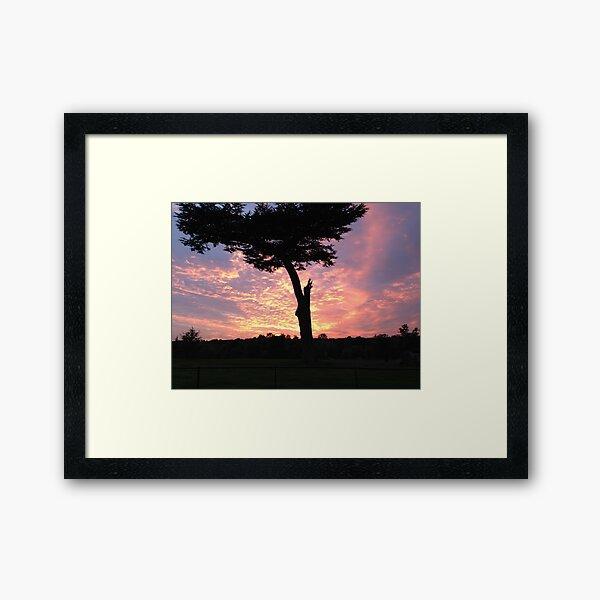 silhouette in molten sky Framed Art Print