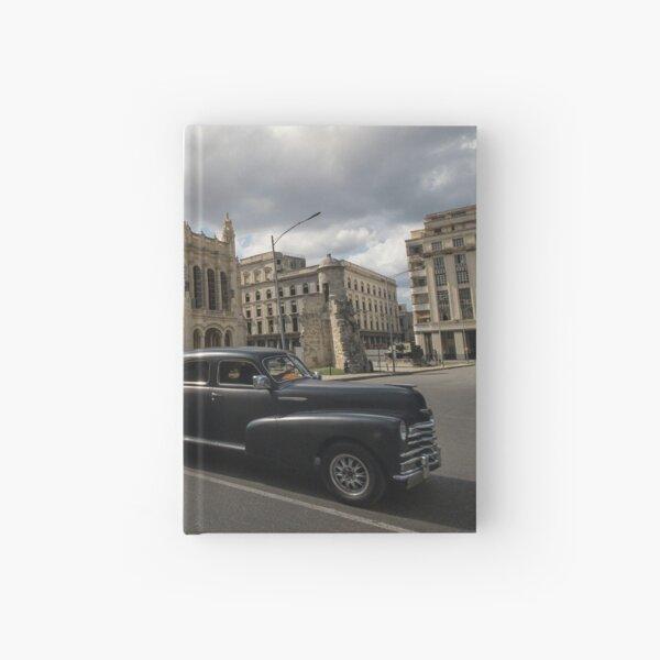 Black american car passing in front of the Revolution Museum, La Havana, Cuba. Hardcover Journal