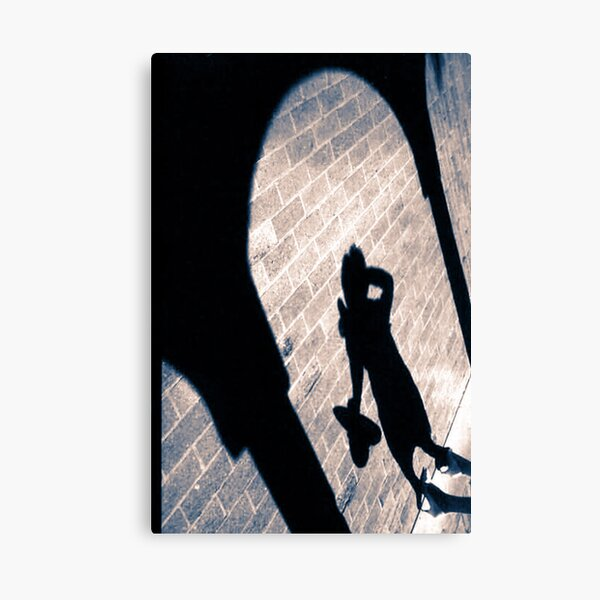 Shadow On The Wall Canvas Print