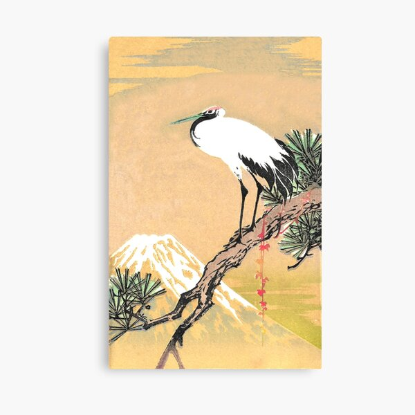 Stork standing on a Pine Tree limb in sight of a Snow covered Mountain Peak Canvas Print