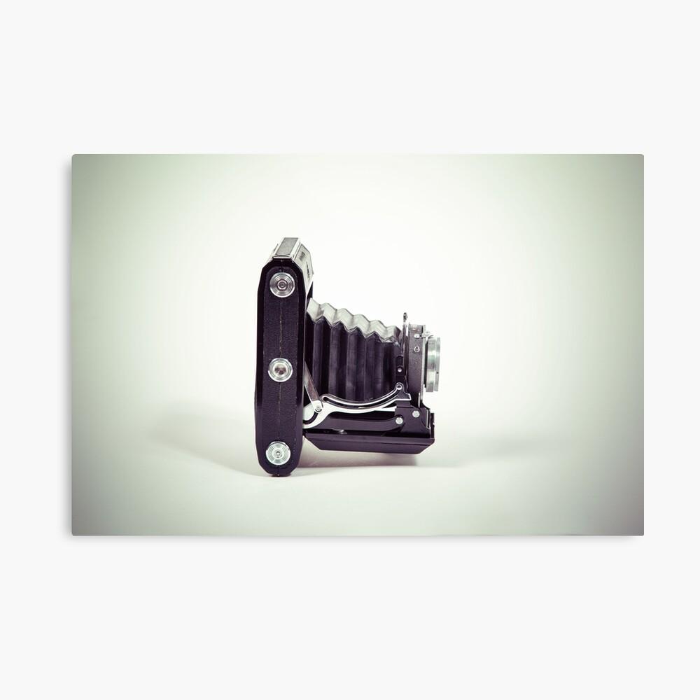 Fotografie - alte analoge Kamera von der Seite Metallbild