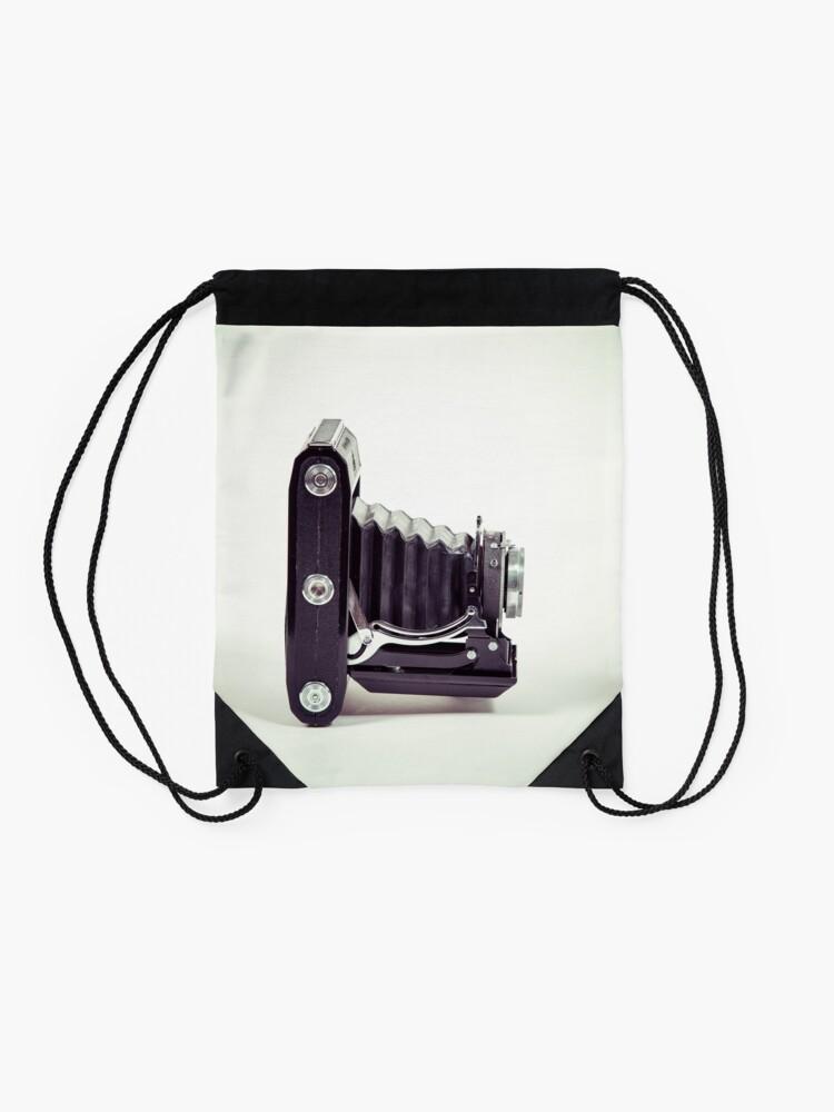 Alternative Ansicht von Fotografie - alte analoge Kamera von der Seite Turnbeutel