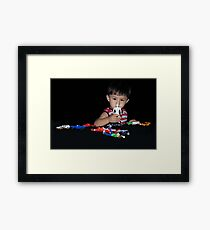 Ryan with his toys. Framed Print