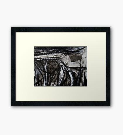 misted moon casts light on ancient remnants Framed Print