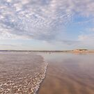 The tide washes in at Westward Ho! beach in North Devon, UK by Zoe Power