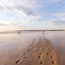 Footprints in the sand at Westward Ho! beach in North Devon, UK by Zoe Power