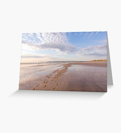 Footprints and reflections at Westward Ho! beach in North Devon, UK Greeting Card