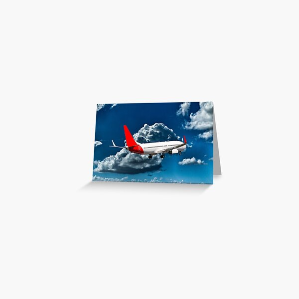 Commercial Aircraft in flight with cloud in blue sky. Greeting Card