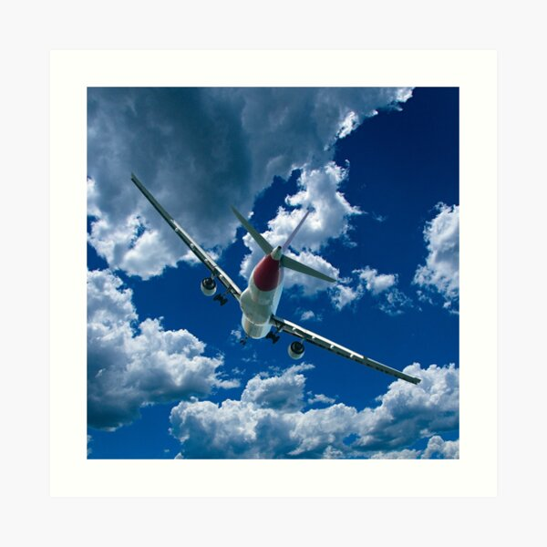 Commercial Aircraft in flight with cloud in blue sky. Art Print