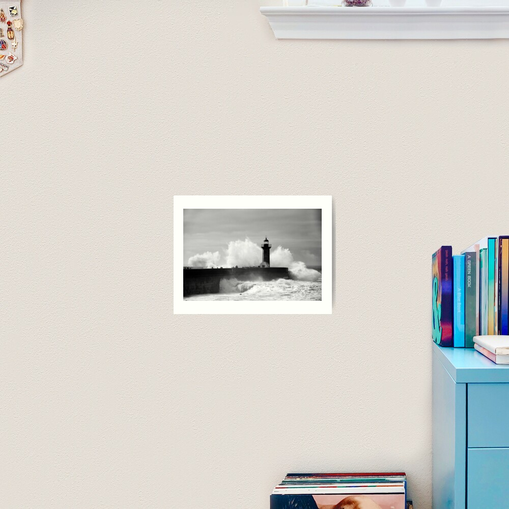 Lighthouse in stormy ocean Art Print