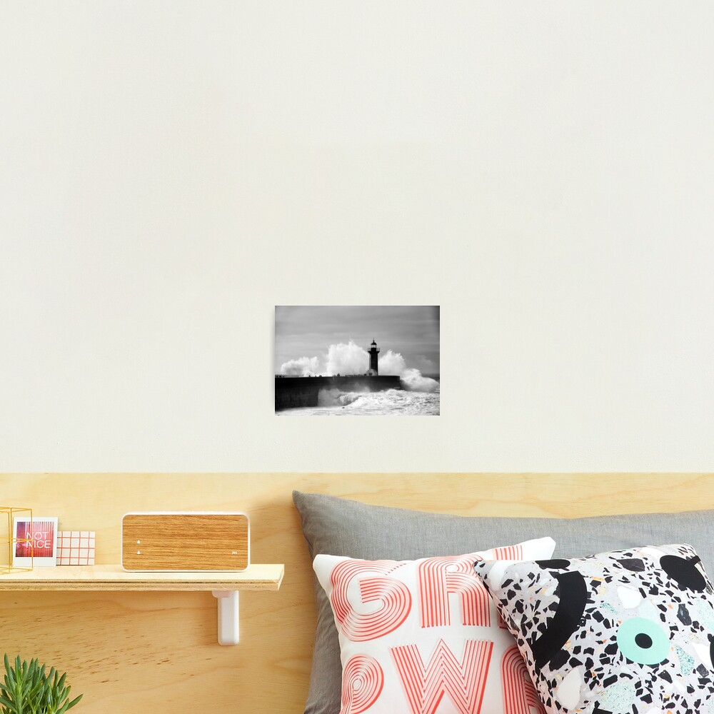 Lighthouse in stormy ocean Photographic Print