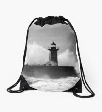 Lighthouse in stormy ocean Drawstring Bag