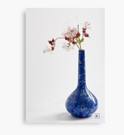 Blue vase with geraniums Canvas Print