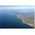 Portugal Aerial image of the Algarve, the Portuguese south coast from Albufeira towards Portimão, Lagos and in the far distance Sagres. by stuwdamdorp