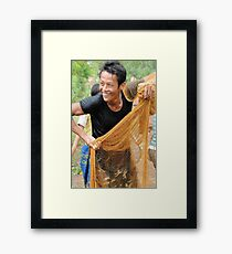 Teaching how to fish with a throw net Framed Print