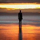 Warm Glow Sunset on Another Place Ironman of Crosby beach by Ian Moran