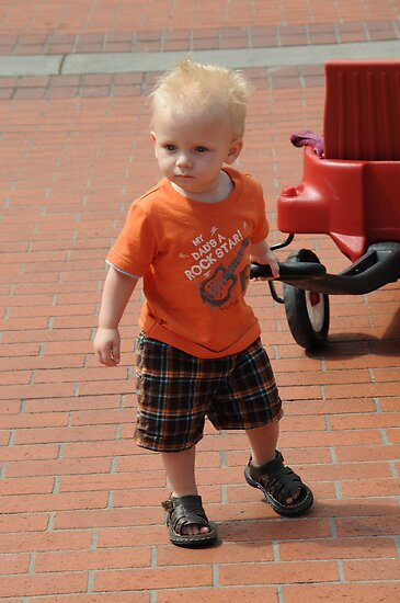 Rylan and his red wagon by Carl LaCasse