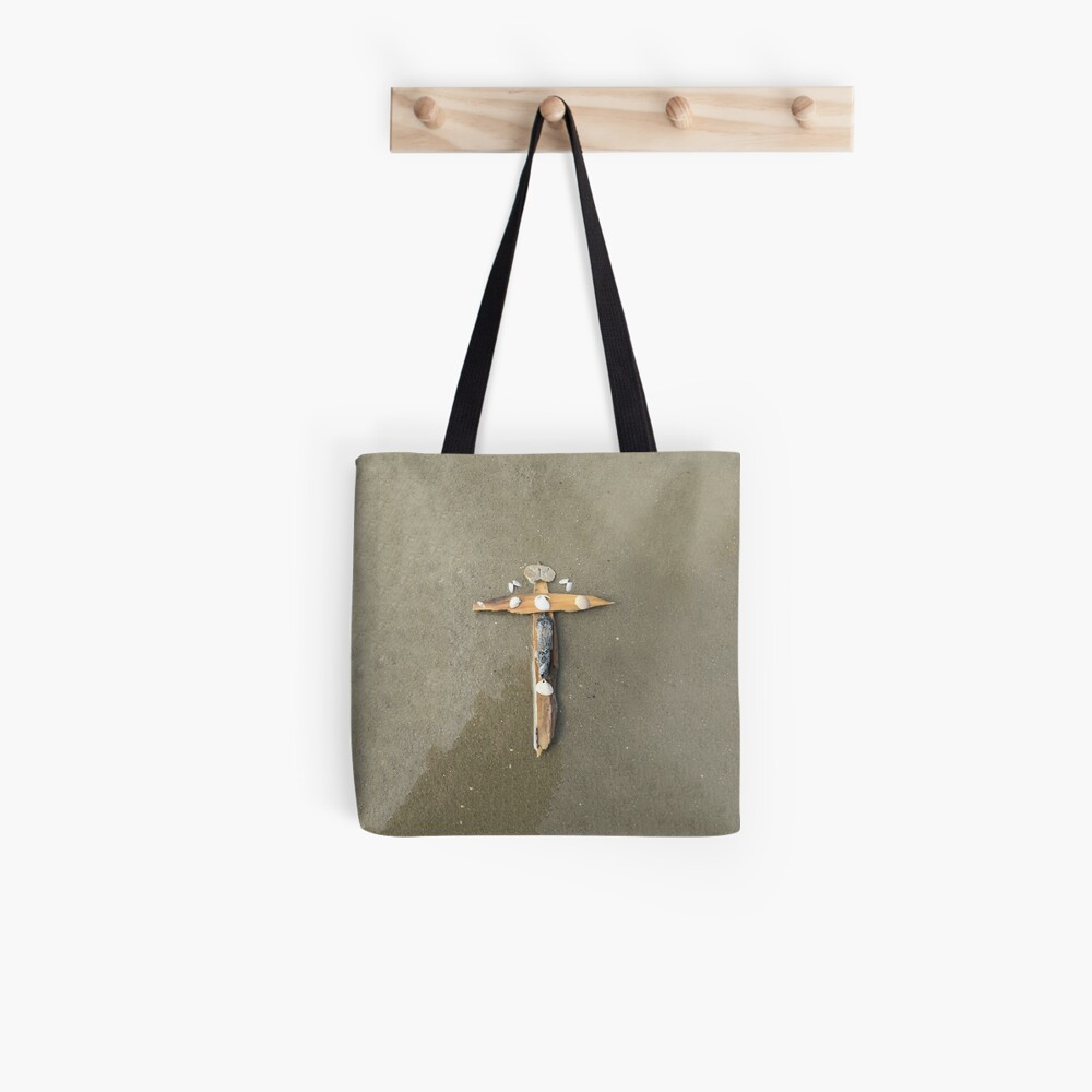 Driftwood cross on beach sand - From ccnow.info Tote Bag