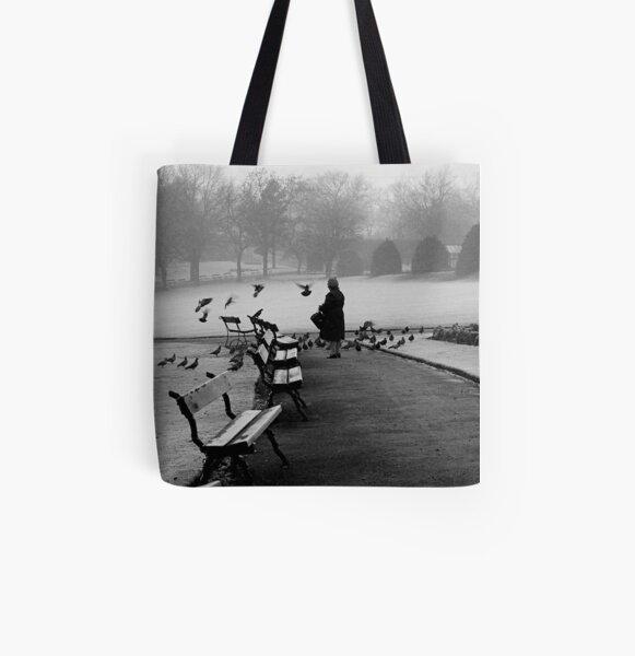 Shy woman feeding pigeons All Over Print Tote Bag