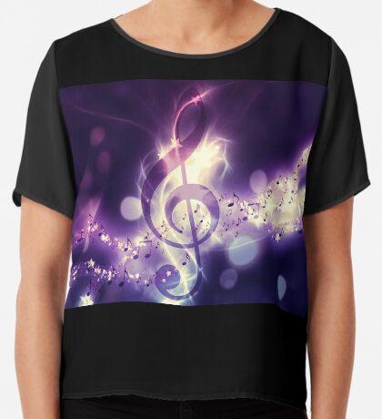 Glühender Musikhintergrund Chiffontop