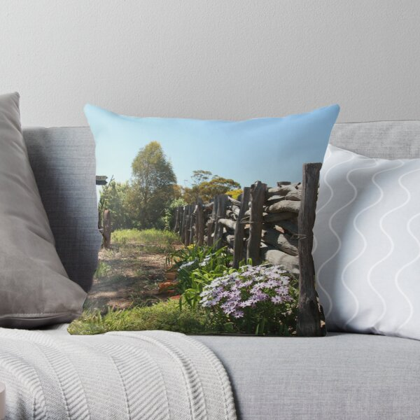 Flowers by the fence Throw Pillow