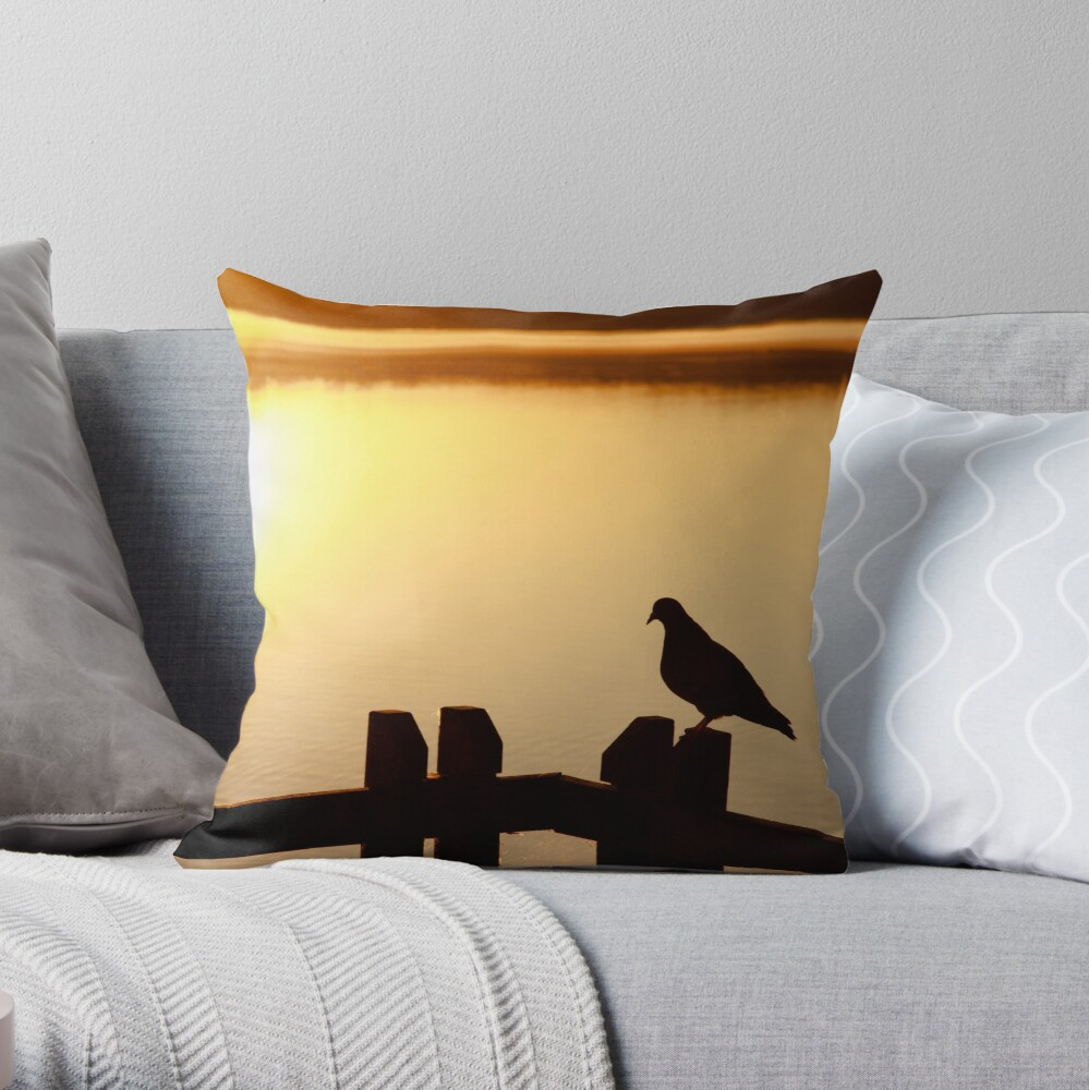 Pigeon sitting on the jetty Throw Pillow