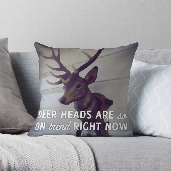 Deer heads are so on trend right now Throw Pillow