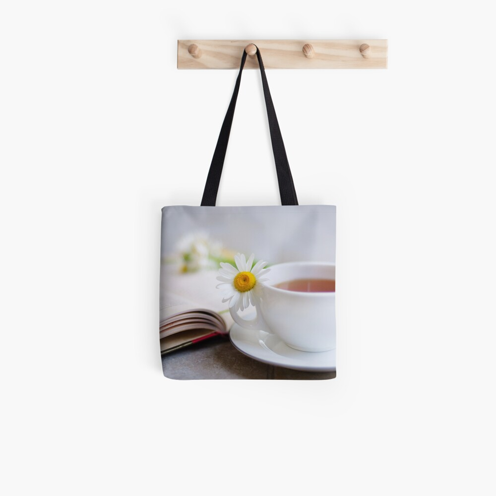 a good book should leave you slightly exhausted at the end. You live several lives while reading it... Tote Bag